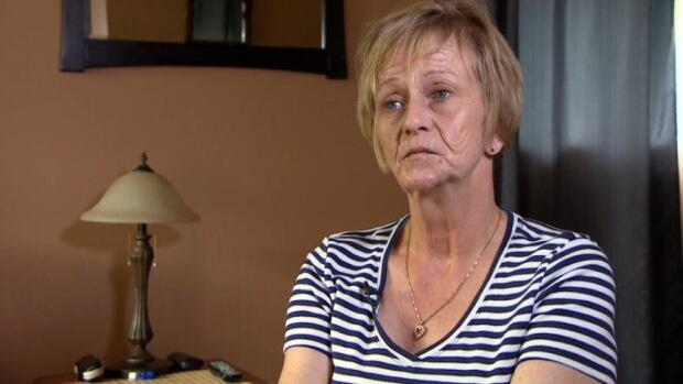 Judy Perrin-Royer's oral surgeon says she is in need of dental implants so she can eat, but the provincial government won't pay for the procedure.