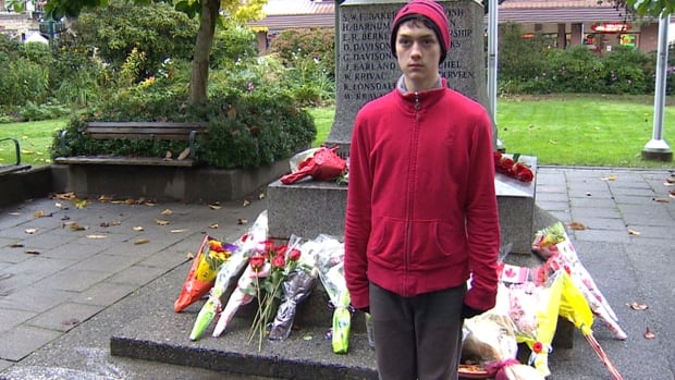 Jackson Reid, 13, is standing guard at the cenotaph in Port Coquitlam, B.C., in honour of two Canadian soldiers slain this week.