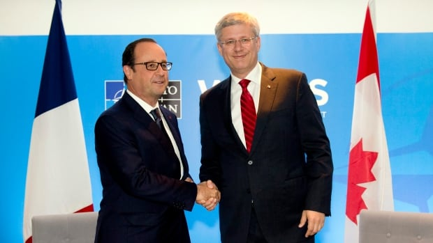 Prime Minister Stephen Harper says the president of France will address Canada's Parliament during his first state visit to Canada Nov. 2-4. French president François Hollande, left, is seen here shaking hands with Harper at a bilateral meeting of the NATO 2014 Summit in South Wales, on Sept. 5, 2014.