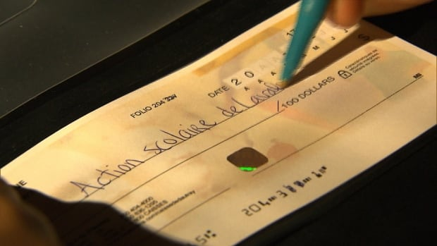 One man tells Radio-Canada he wrote cheques to candidates in Laval school board elections and was later reimbursed.<br />