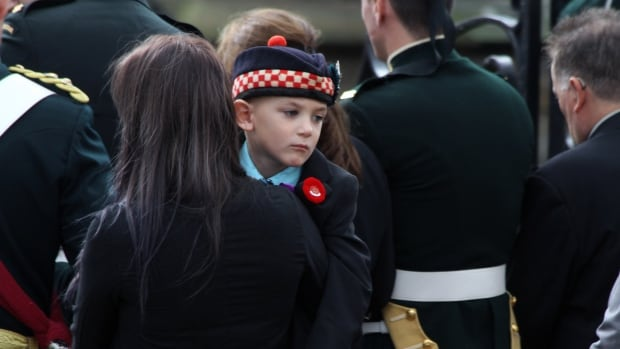 Cpl. Nathan Cirillo's son Marcus attends his father's funeral in Hamilton on Monday.  The families of Cirillo and Warrant Officer Patrice Vincent will receive the money donated to the Stand on Guard Fund, which reached $705,000 as of midnight.