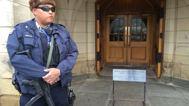 An RCMP officer holds an MP5 submachine gun while guarding the entrance to Centre Block used by members of Parliament. Incident reports from the RCMP show Parliament Hill had only minor security incidents in the months leading to the Oct. 22 shooting last year.