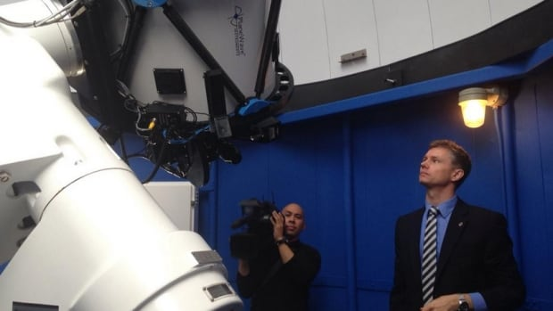 Dr. Rob Thacker (right) shows media around the Burke-Gaffney Observatory's new observation deck.