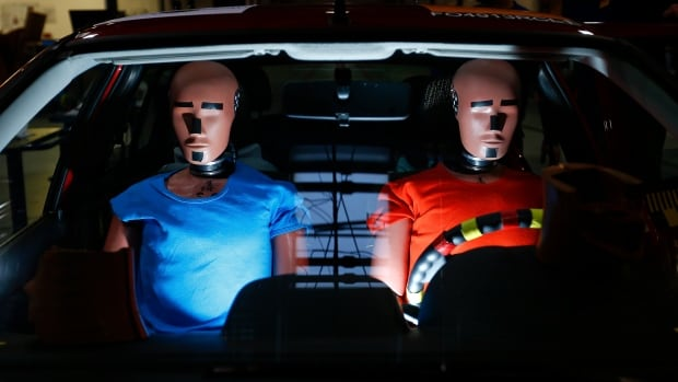 Dummies are prepared for a crash test at the laboratory of the German motor club ADAC in Landsberg on Dec. 5, 2013.  A global manufacturer of crash test dummies, based in the U.S., is making bigger dummies to better match the obese portion of the American population.