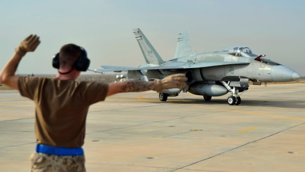 A Canadian Armed Forces CF-18 Fighter jet from 409 Squadron taxis after landing in Kuwait on Oct. 30.
