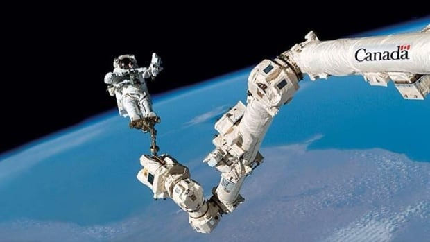 The version of the photo posted on federal government websites feature the logo on a part of the arm where such a logo doesn't exist on NASA versions of the photo. The Canadian Space Agency credits the photo to Canadian astronaut Jeremy Hansen, who has never flown in space.