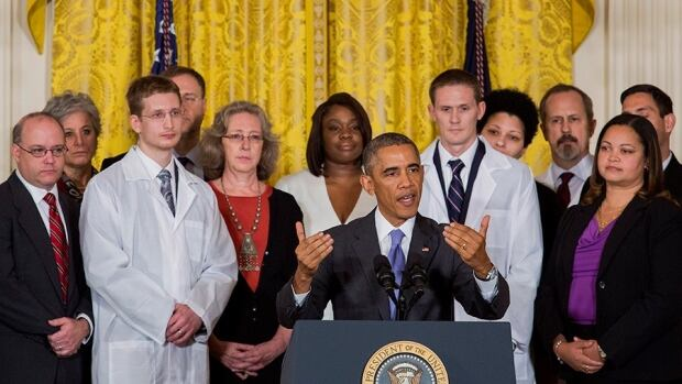 Dr. David Peters, third from the left in the back row, along with 10 other health care professionals, is publicly praised by U.S. President Barack Obama for his work fighting Ebola in Liberia in October.