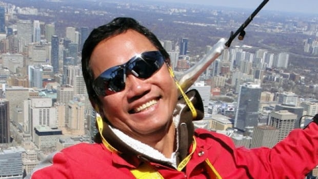 Caesar Rosales walking the CN Tower in an undated photo. Rosales, a father of one and aerospace worker, also enjoyed skydiving, bungy jumping and ziplining. He was stabbed to death in a random attack on a city bus in Kelowna, B.C. on Thursday Oct. 30, 2014.