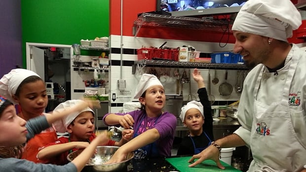 Chef Camilo Torres instructs his young charges on how to prepare broccoli bites, and hopes they'll sustain good eating habits through adulthood.
