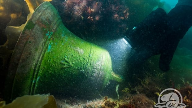 The detached ship's bell of HMS Erebus, found on the deck next to the windlass (a kind of winch positioned near the bow), was the first item extracted from the wreck. It is now in a Parks Canada lab, where salt is slowly being extracted so the bell can be preserved.