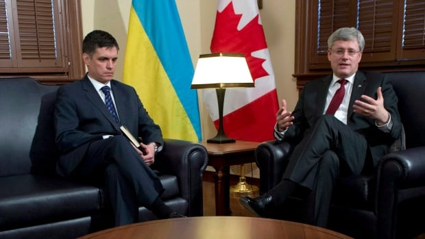Vadym Prystaiko, the outgoing Ukrainian ambassador to Canada, is disappointed Stephen Harper's government sent its CF-18s to fight ISIS but refused military support for Ukraine during its time of crisis. Prystaiko and Harper are shown here during a joint photo call in the early days of the crisis in March.