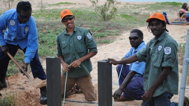 Daryl Lacey, centre, is a senior indigenous park ranger with the Dhimurru Indigenous Protected Area in Australia's Northern Territory.  All the rangers in the IPA are members of the Yolngu people.