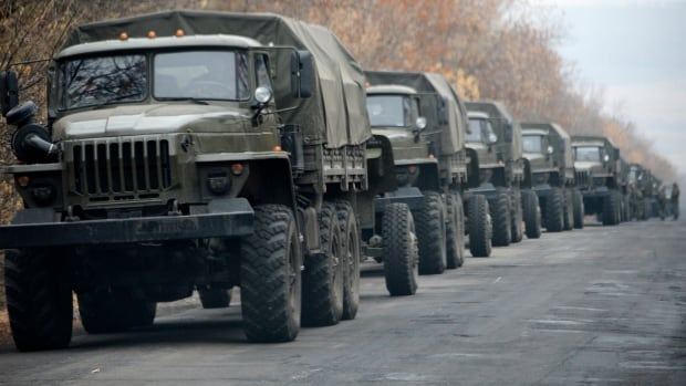 European observers say these unmarked military vehicles, outside the separatist rebel-held eastern Ukrainian town of Snizhne, 80 kilometres from Donetsk, are believed to have been sent by Moscow.