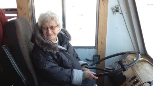 Pauline Page tries out the driver's seat on the Churchill tundra buggy.
