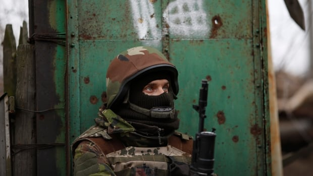 A Ukrainian volunteer fighter stands guard in the village of Peski near Donetsk. The area has seen some of the intense fighting in the conflict in the past several weeks, despite an ongoing ceasefire signed two months ago in Minsk, Belarus.