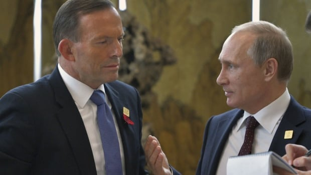 Australia's Prime Minister Tony Abbott, left, said Russia is 'being much more assertive,' as the Russian embassy said on Friday that Russia's Pacific fleet was testing its range, and could be used as security for Vladimir Putin, right.