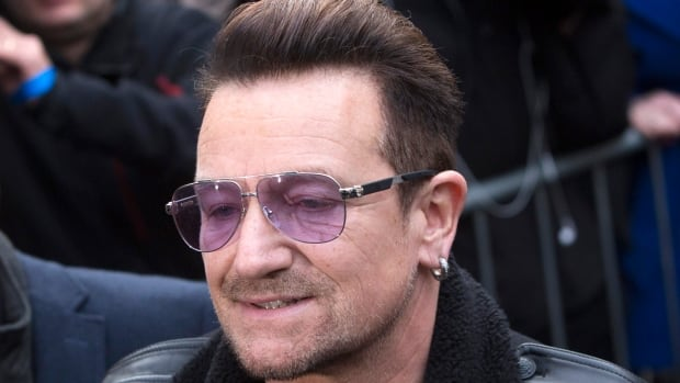 U2 lead singer Bono is shown arriving on Saturday for the Band Aid 30 charity single in London.