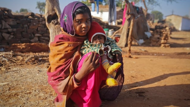 Krishna, 14, pictured with her four-month-old baby Alok in 2013, married her husband Gopal when she was 11 and he was 13. International efforts to end child, early and forced marriage are getting $10 million from Canada, Foreign Affairs Minister Rob Nicholson said Wednesday.
