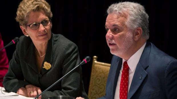 Ontario Premier Kathleen Wynne and Quebec Premier Philippe Couillard chair a joint cabinet meeting at the Ontario Legislature in Toronto on Friday.