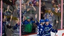 Canucks celebrate Daniel Sedin's big night with win