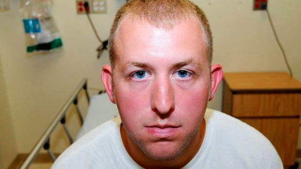 Police officer Darren Wilson is pictured shortly after he shot and killed Michael Brown. The photo was part of the evidence presented to a grand jury in Ferguson, Mo., and released Nov. 24 following the jury's decision not to indict Wilson.