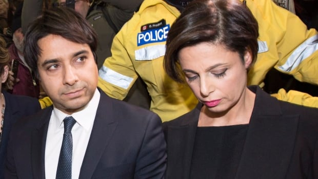 Jian Ghomeshi leaves court in Toronto, Wednesday, Nov.26, 2014. Ghomeshi has been granted bail just hours after being charged with multiple counts of sexual assault.