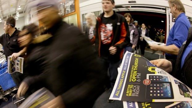 Shoppers rush into a U.S. Best Buy on Black Friday in 2013. Many Hamilton shoppers are expected to head to Buffalo in search of steep discounts on big ticket items tomorrow.