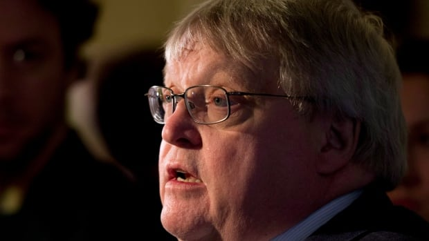 Quebec Health Minister Gaétan Barrette responds to reporters' questions following a caucus meeting Wednesday, Nov. 19, 2014 at the legislature in Quebec City.