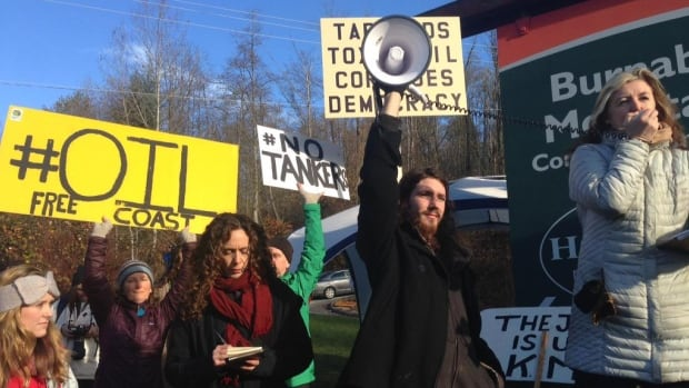 Protesters rally on Burnaby Mountain as Kinder Morgan begins dismantling its testing site.