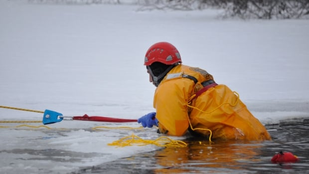 Arctic Response Canada's Adam Woogh says it's important to be prepared and have the right equipment if you're going to go hunting near frozen lakes or rivers. In this photo, a team demonstrates how to use survival equipment to rescue someone who who has fallen through the ice during an Arctic winter.