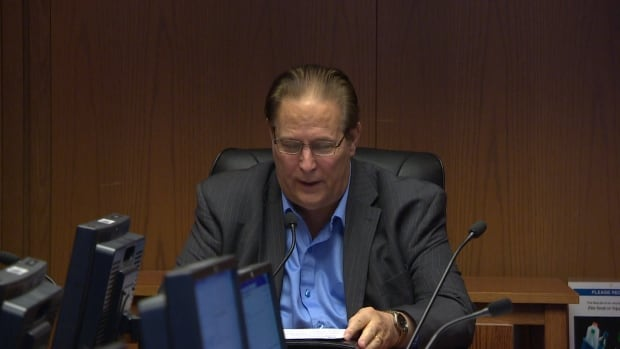 David Sanders, seen at a city committee meeting in November 2014, says councillors should reject a plan to expropriate property that the city had swapped five years ago and now needs back for the planned BRT route to the University of Manitoba.