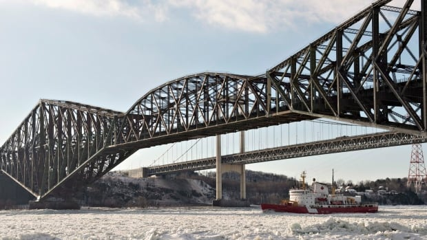 The rusting Pont du Québec has been named a National Historic Site, however governments and CN have been unable to agree on who should pay to finish repainting it.