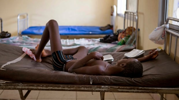 A child suffering from the Ebola virus receives treatment at a holding centre in Sierra Leone. The country will soon see a dramatic increase in desperately needed Ebola treatment beds.