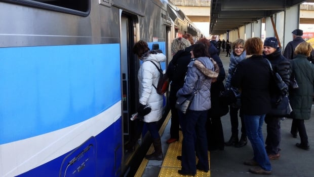 Passengers board the Train de l'est at Repentigny station.