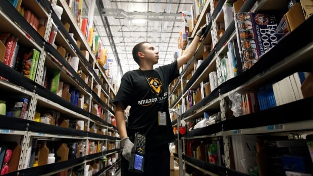 A worker gathers items for delivery from the warehouse floor at Amazon's distribution center in Phoenix, ahead of last year's Cyber Monday. A recent survey by Deloitte Canada found that four out of five online shoppers were worried about the security of their personal data when shopping.