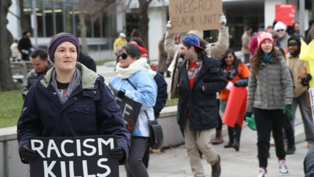 """Attendees carried homemade signs on Dec. 1's """"Black, Brown and Red Lives Matter"""" march through downtown Hamilton."""