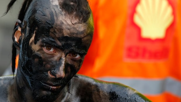 A Greenpeace activist protests against an oil development in Poland. While cheap oil has lots of winners and losers, on the whole it's probably bad for the environmental movement.