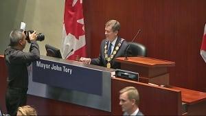 Mayor John Tory sitting in mayor's chair