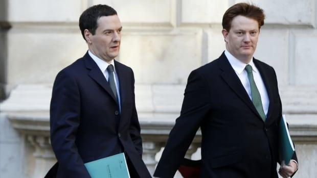 Britain's Chancellor of the Exchequer George Osborne, left, with his deputy Danny Alexander head to the House of Commons to deliver the autumn statement on Wednesday. Osborne announced a 25 per cent tax on multinational profits shifted out of the country.