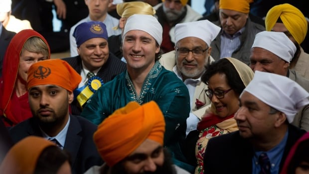 Liberal Party Leader Justin Trudeau, centre, attended a ceremony at the Khalsa Diwan Society Sikh Temple before the Vaisakhi parade in Vancouver in April. Trudeau told CBC News he didn't force Barj Dhahan to withdraw his nomination bid.