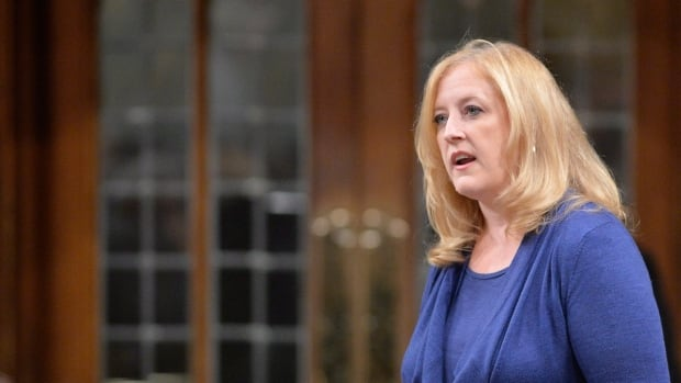 Federal Minister of Transport Lisa Raitt says a growth removed in surgery last month wasn't cancerous.