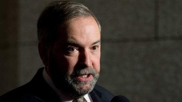NDP leader Tom Mulcair speaks with the media following party caucus on Parliament Hill in Ottawa, Wednesday December 3, 2014.