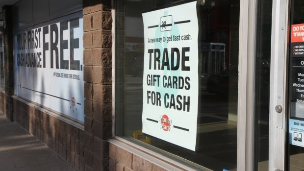 A poster in the window at Money Mart on James Street North and Wilson Street in Hamilton on Thursday offered 'a new way to get fast cash.'