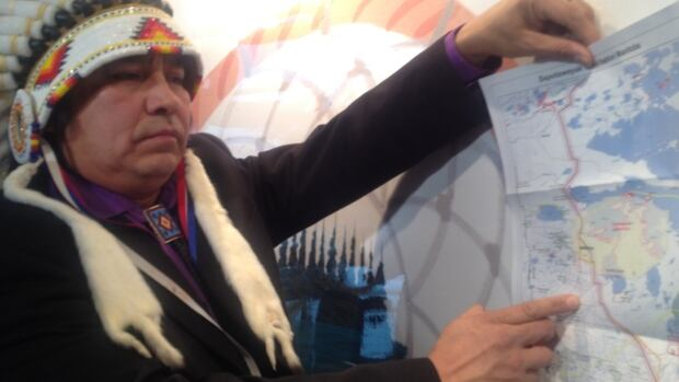 Chief Nelson Genaille shows where Bipole III cuts through his community's lands.