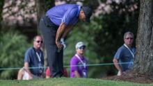 Tiger Woods vomits on 1st hole, makes birdie