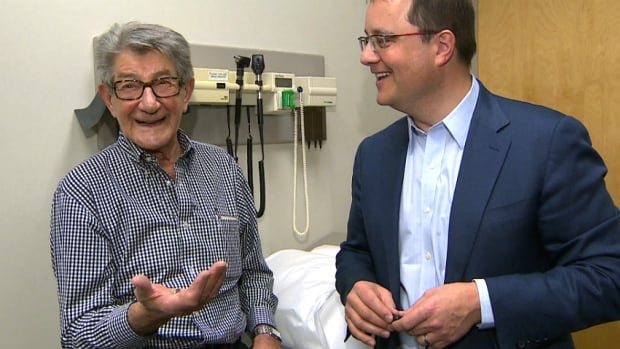 Victor Bohonos, left, has a check-up with Dr. Derek Exner at the Foothills hospital three months after he had the world's smallest pacemaker implanted.