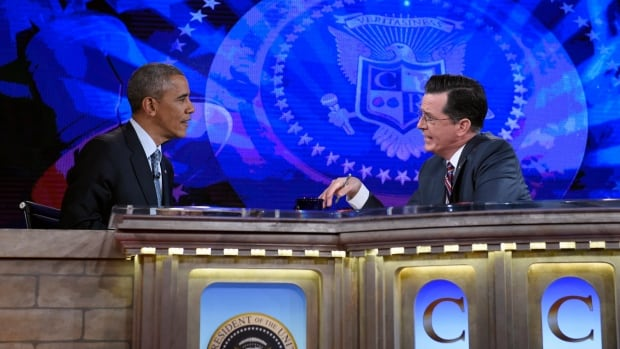 U.S. President Barack Obama talks with Stephen Colbert of The Colbert Report during a taping of the program in Lisner Auditorium at George Washington University in Washington, Monday, Dec. 8, 2014.