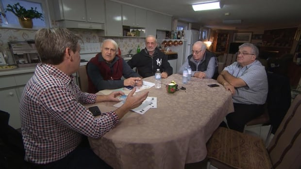 A group of Toronto seniors, seen here with CBC's John Lancaster (far left), claim they were kicked out of the North Islington Seniors Club because they did not support Coun. Giorgio Mammoliti.