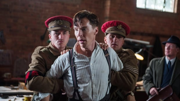 """In this image released by The Weinstein Company, Benedict Cumberbatch, center, appears in a scene from """"The Imitation Game."""" (AP Photo/The Weinstein Company, Jack English)"""