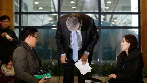 "Korean Air chairman Cho Yang-ho, bows for an apology at its head office in Seoul, South Korea on Friday. Chairman Cho apologized Friday for the behavior of his adult daughter who delayed a flight in an incident now dubbed ""nut rage."""